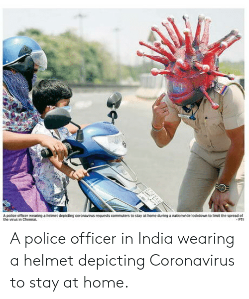 Coronavirus: A police officer in India wearing a helmet depicting Coronavirus to stay at home.