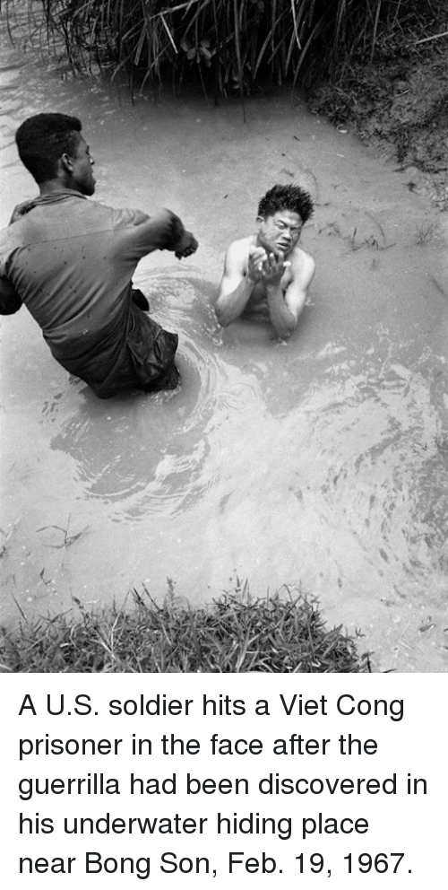 viet cong: A U.S. soldier hits a Viet Cong prisoner in the face after the guerrilla had been discovered in his underwater hiding place near Bong Son, Feb. 19, 1967.