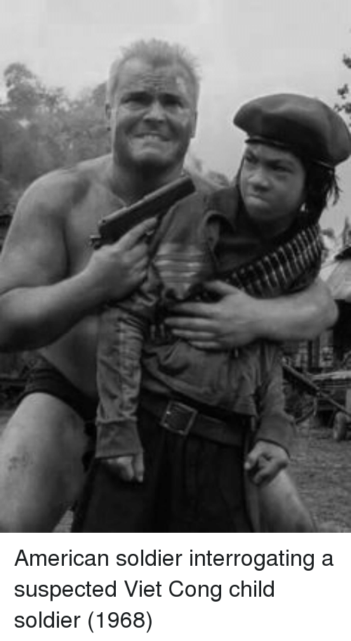 viet cong: American soldier interrogating a suspected Viet Cong child soldier (1968)