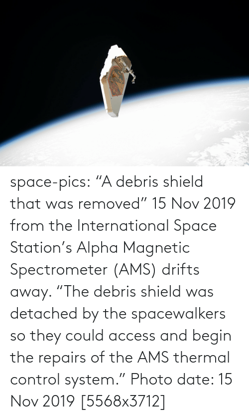 "Begin: AMS-02 space-pics:  ""A debris shield that was removed"" 15 Nov 2019 from the International Space Station's Alpha Magnetic Spectrometer (AMS) drifts away. ""The debris shield was detached by the spacewalkers so they could access and begin the repairs of the AMS thermal control system."" Photo date: 15 Nov 2019 [5568x3712]"