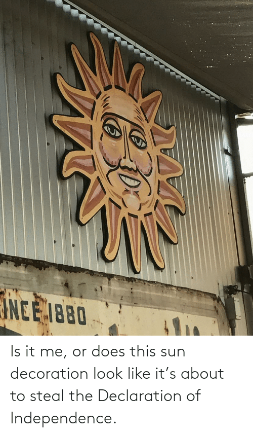 Decoration: Is it me, or does this sun decoration look like it's about to steal the Declaration of Independence.