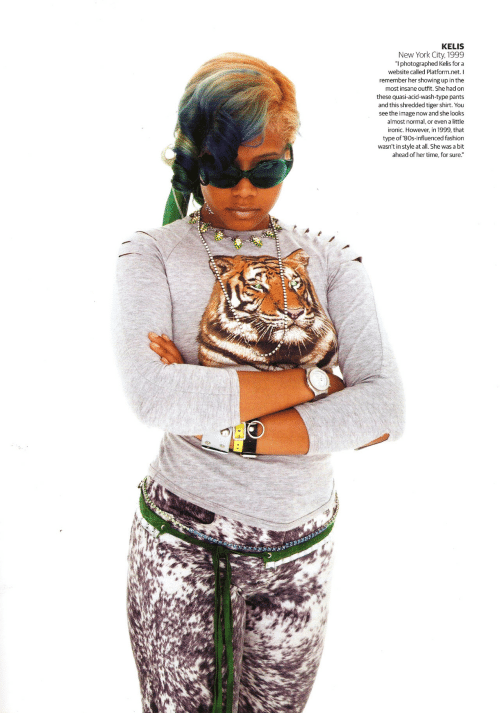 "Ironic: KELIS  New York City, 1999  ""I photographed Kelis for a  website called Platform.net. I  remember her showing up in the  most insane outfit. She had on  these quasi-acid-wash-type pants  and this shredded tiger shirt. You  see the image now and she looks  almost normal, or even a little  ironic. However, in 1999, that  type of '80s-influenced fashion  wasn't in style at all. She was a bit  ahead of her time, for sure."""