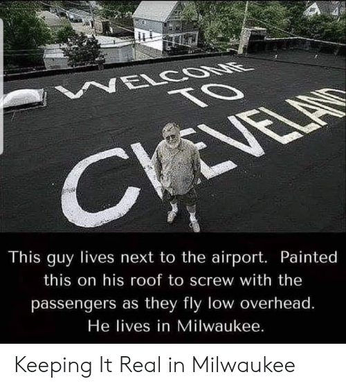 screw: NELCOONE  TO  CVEVELAS  This guy lives next to the airport. Painted  this on his roof to screw with the  passengers as they fly low overhead.  He lives in Milwaukee. Keeping It Real in Milwaukee
