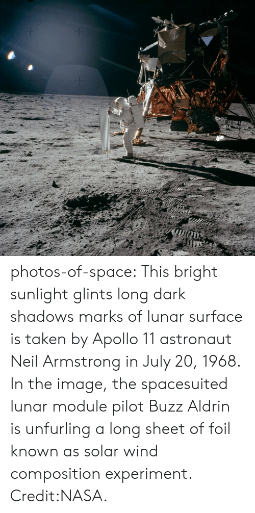 Buzz Aldrin: photos-of-space:  This bright sunlight glints  long dark shadows marks of lunar surface is taken by Apollo 11 astronaut Neil Armstrong in July 20, 1968. In the image, the spacesuited lunar module pilot Buzz Aldrin is unfurling a long sheet of foil known as solar wind composition experiment. Credit:NASA.